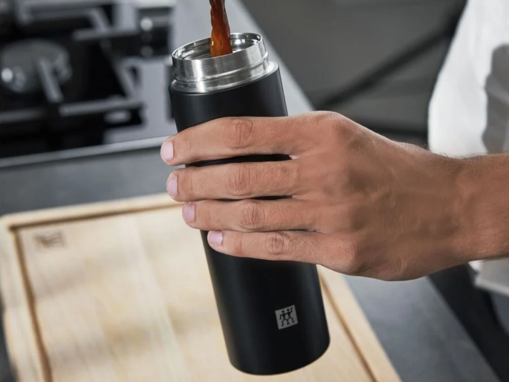 coffee being poured in zwilling thermo bottle