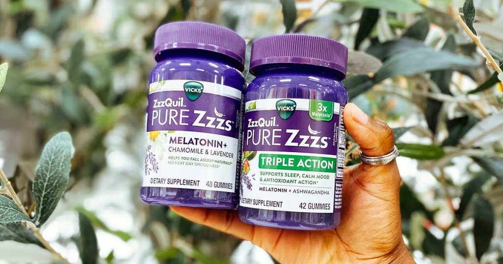 hand holding two bottles of zzzquil suppliments