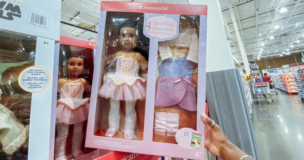 holding an American Girl doll at Costco