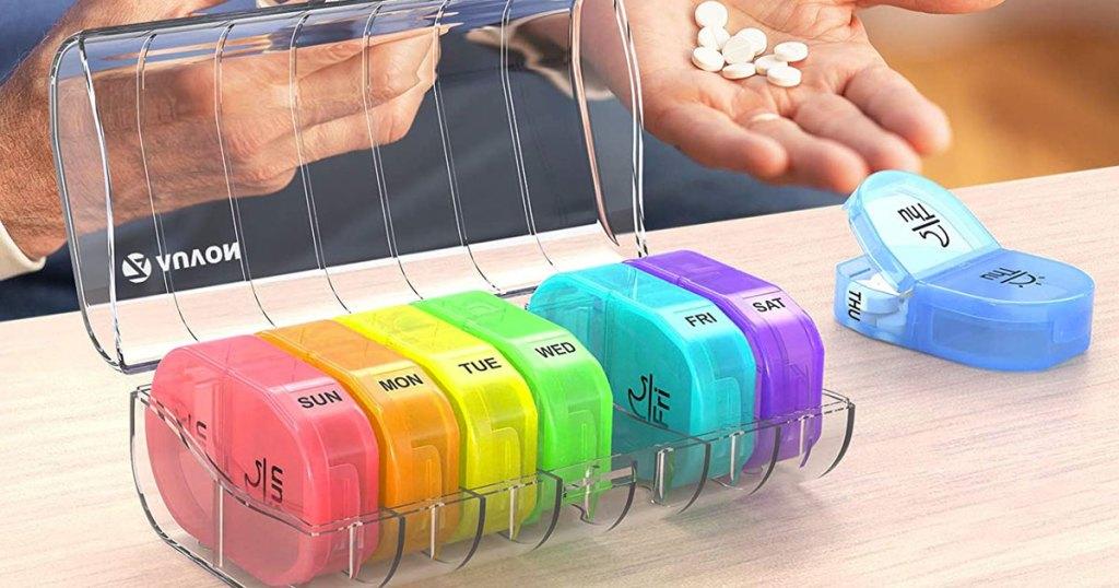 multicolor pill organizer containers