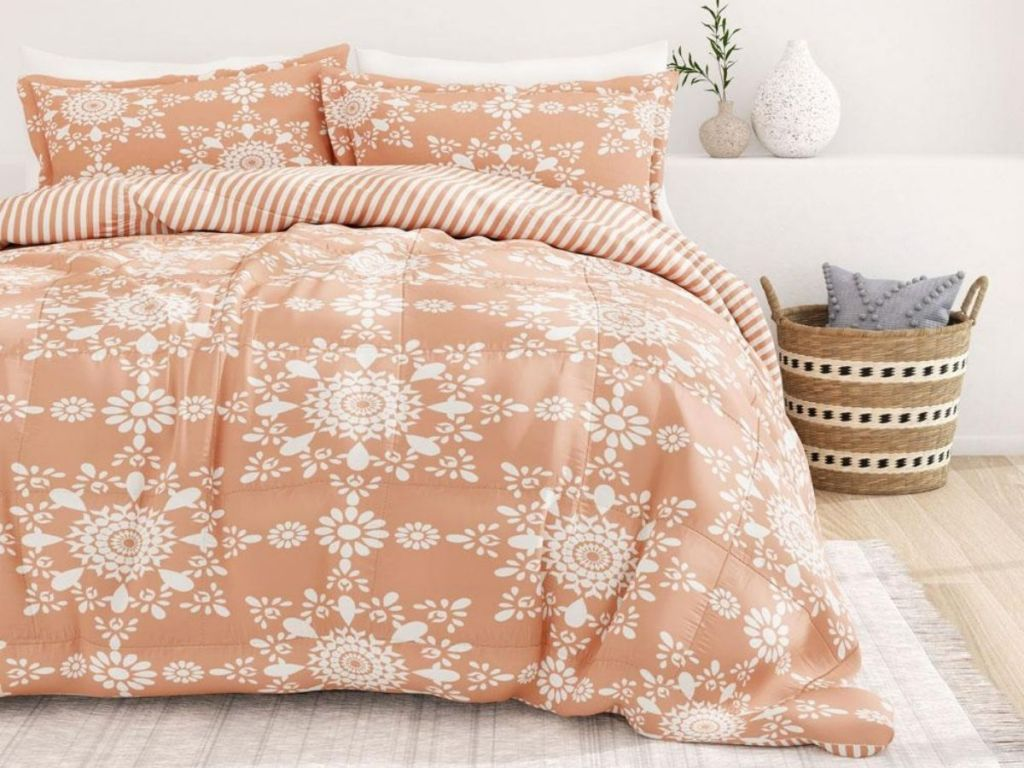 peach and white bedding on bed