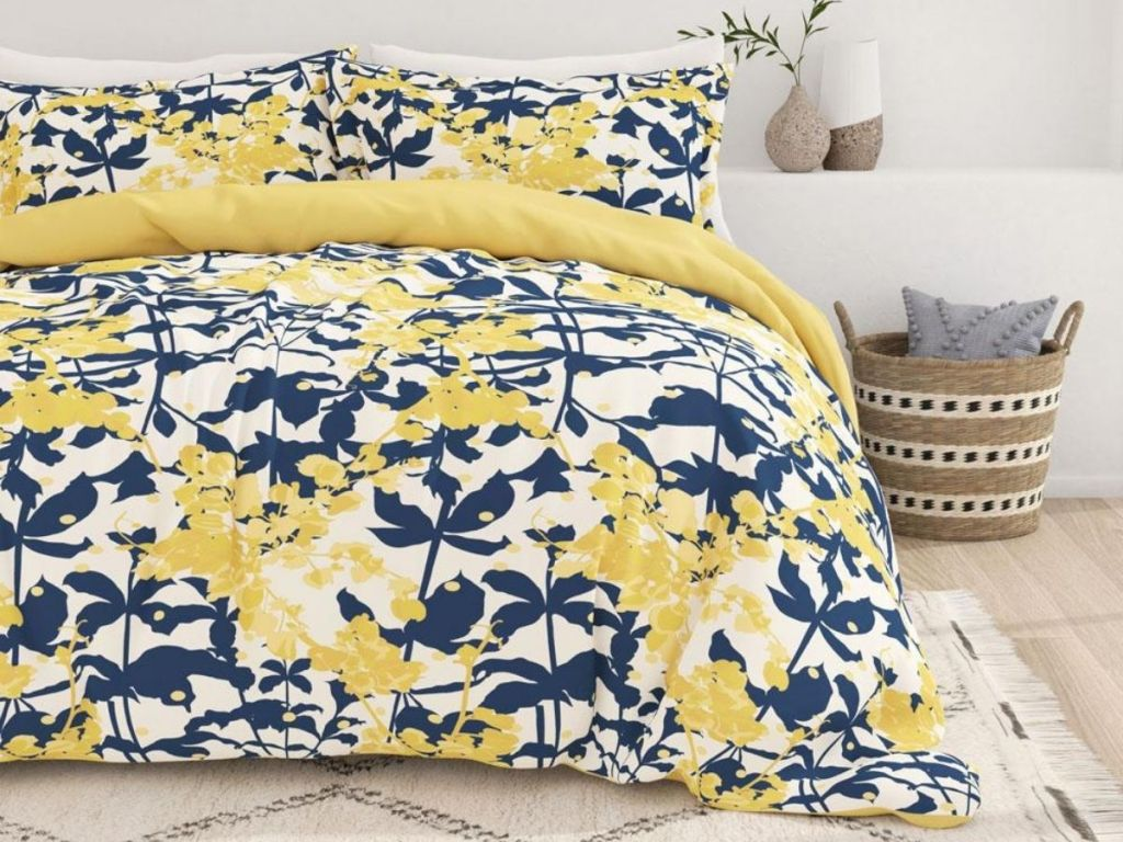 yellow and navy flower bedding on bed