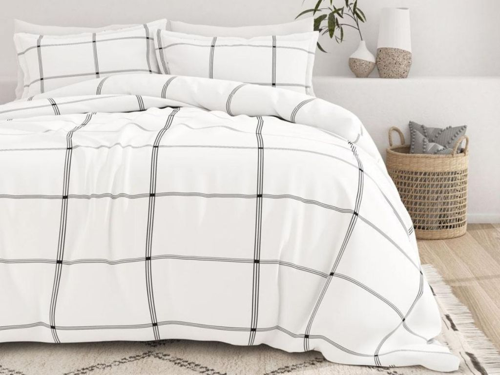 white and black comforter on bed