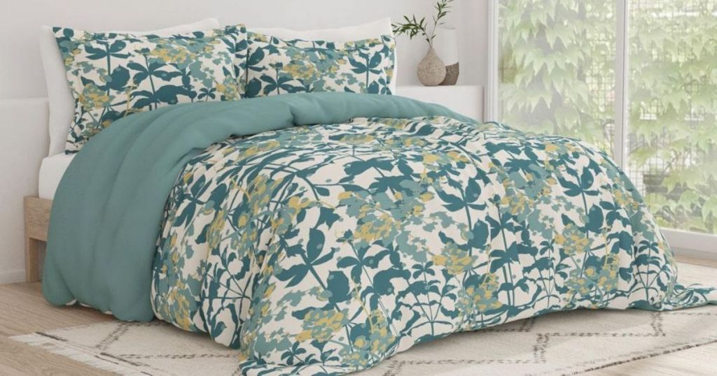 green and yellow flower comforter on bed