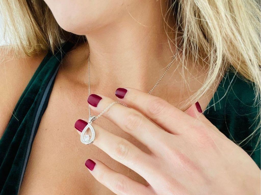 woman wearing teardrop necklace