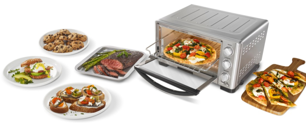 toaster oven with pizza in it and food surrounding it