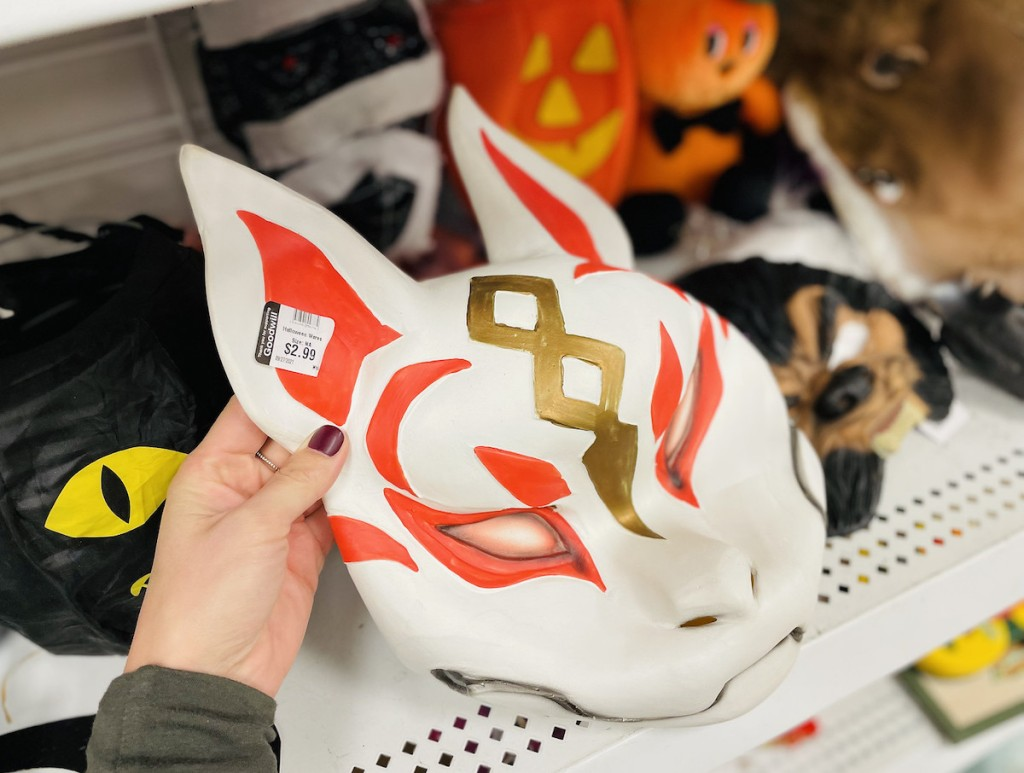 hand holding a thrift store fortnite mask