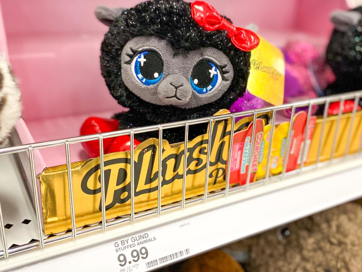 store shelf with stuffed kitty with big eyes