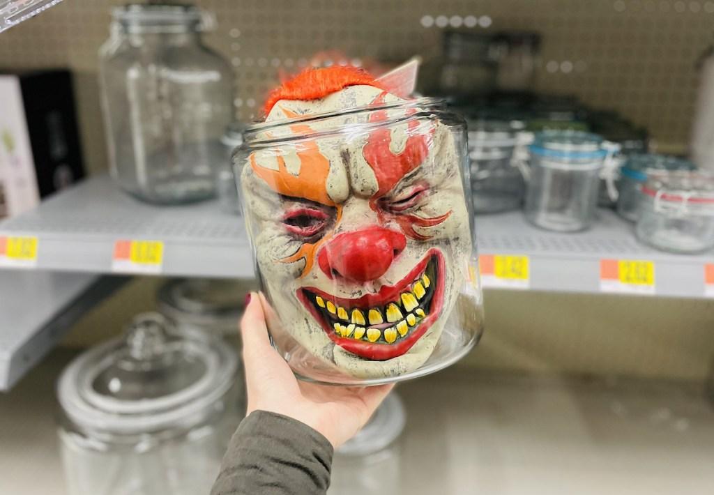 halloween clown mask in clear glass jar in walmart store aisle