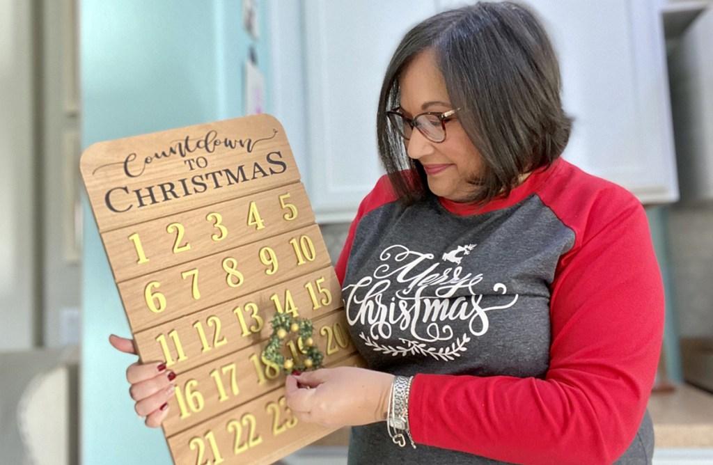 woman wearing christmas shirt with advent calendar
