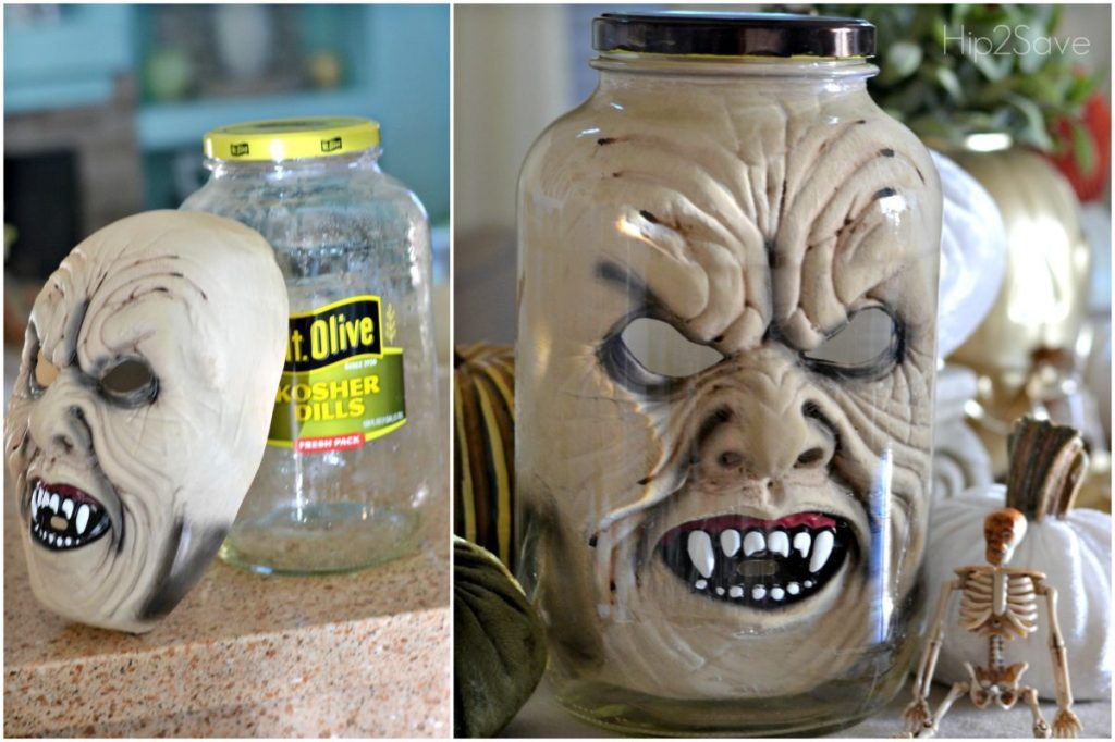 halloween face mask in pickle jar on kitchen counter