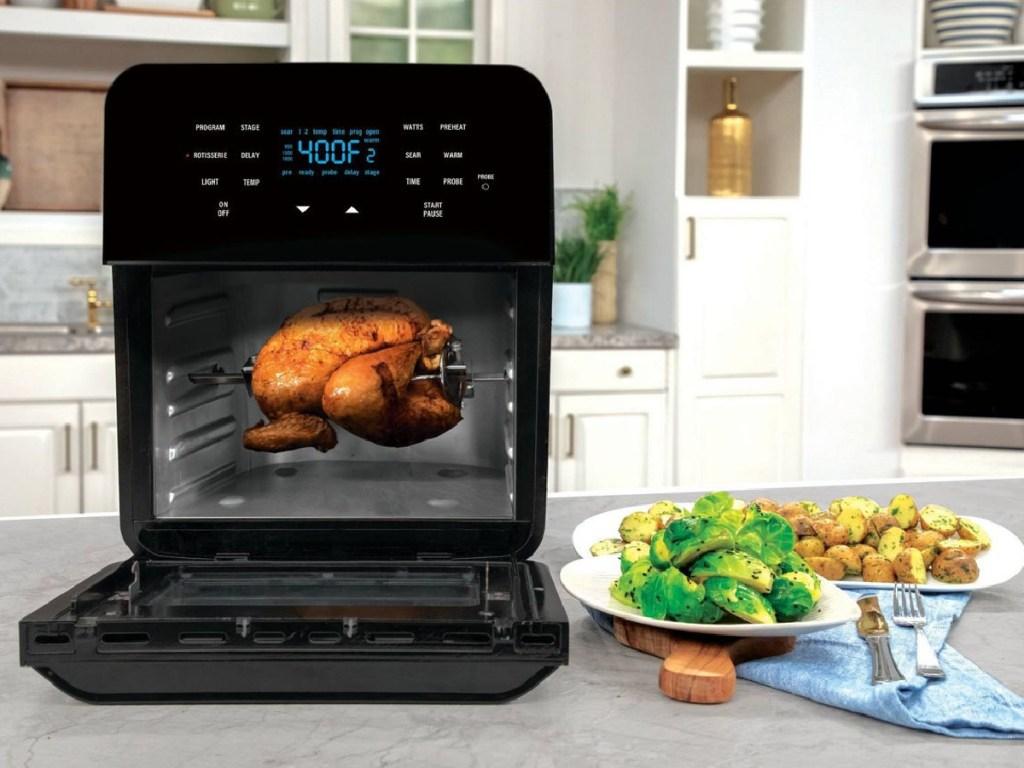 nuwave brio air fryer w/ chicken inside
