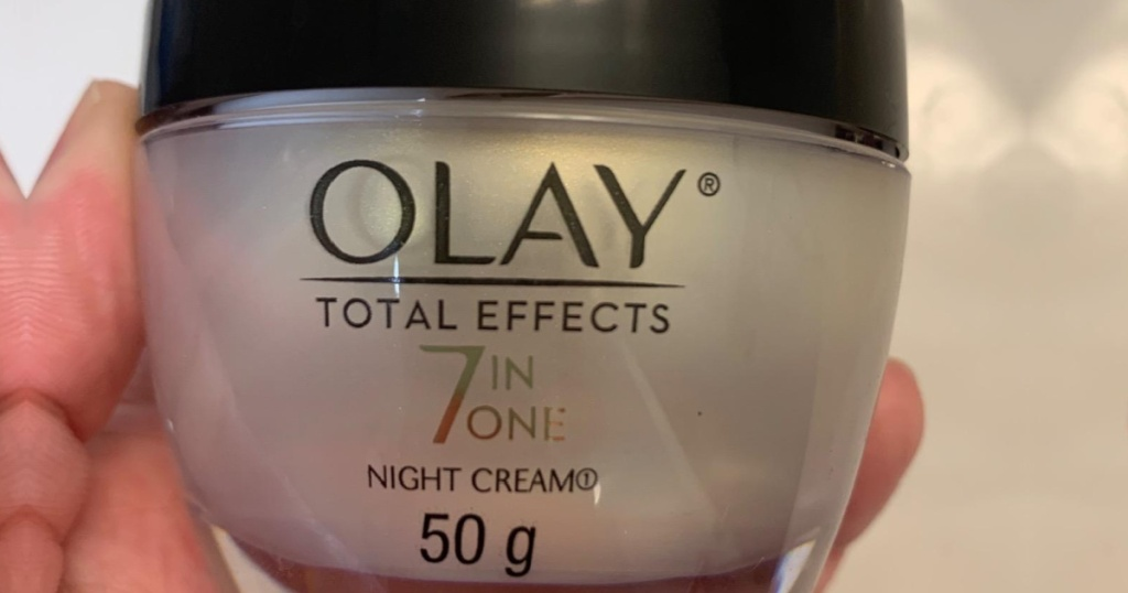 olay 7in 1 night cream in hand