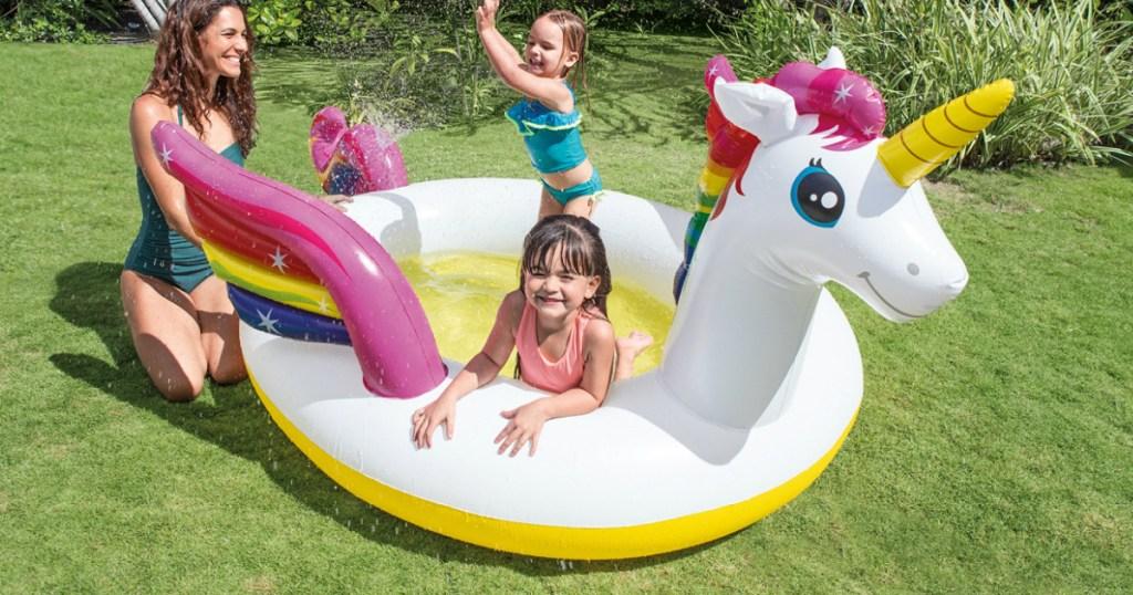 kids inside unicorn spray pool