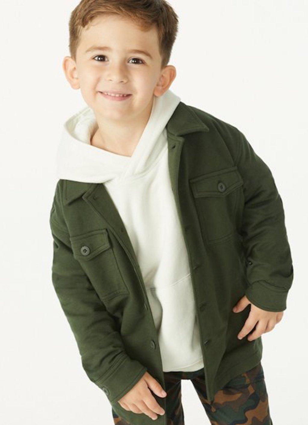 stock photo of boy wearing dark green jacket and white sweatshirt