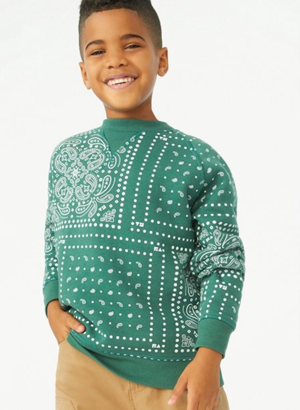 stock photo of boy wearing green sweater
