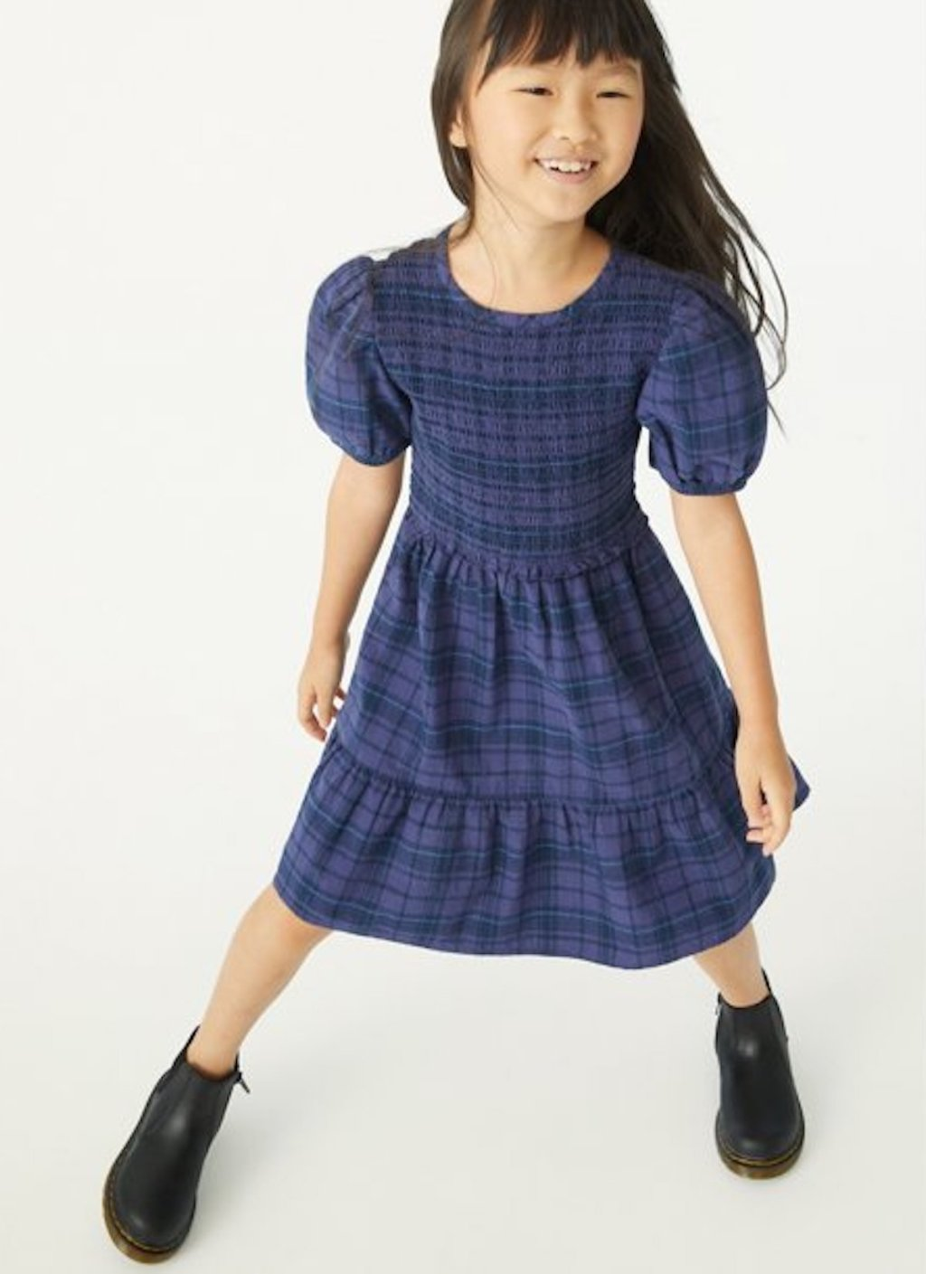 stock photo of girl wearing purple plaid dress
