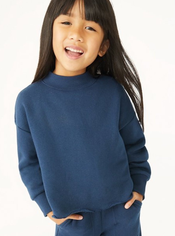 stock photo of girl wearing blue sweater